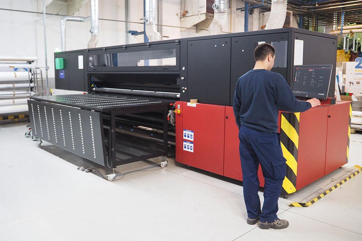 Press operator operating a large format Jeti Tauro digital printer