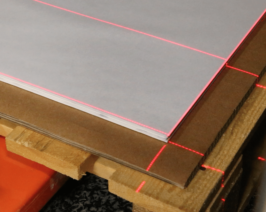 Laser lines indicate the correct position of the pallet