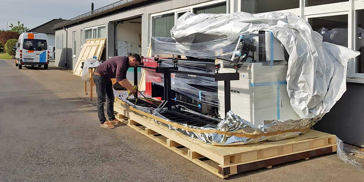 Unpacking the Anapurna large-format printer at Streckfuss